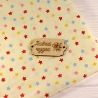 """Ткань """"Цветные звёздочки"""" на жёлтом фоне"""